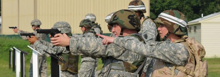 Soldiers firing 9mm ammunition